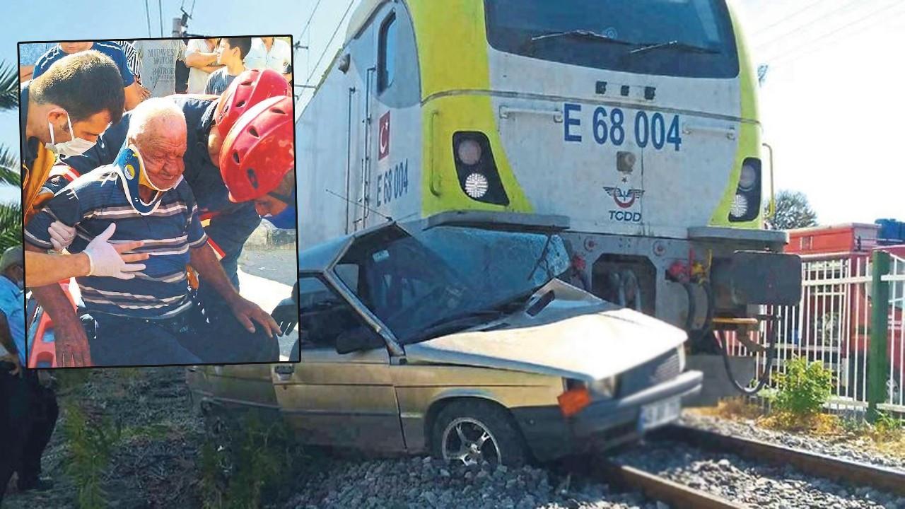 Trenin çarptığı otomobilden sağ çıktı